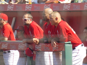 Albert Pujols (center) and Mike Trout (right) chat in the dugout
